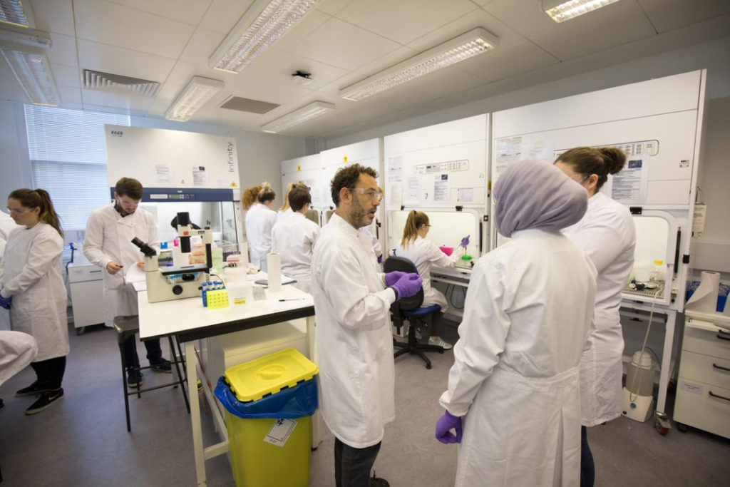 People chatting in a lab