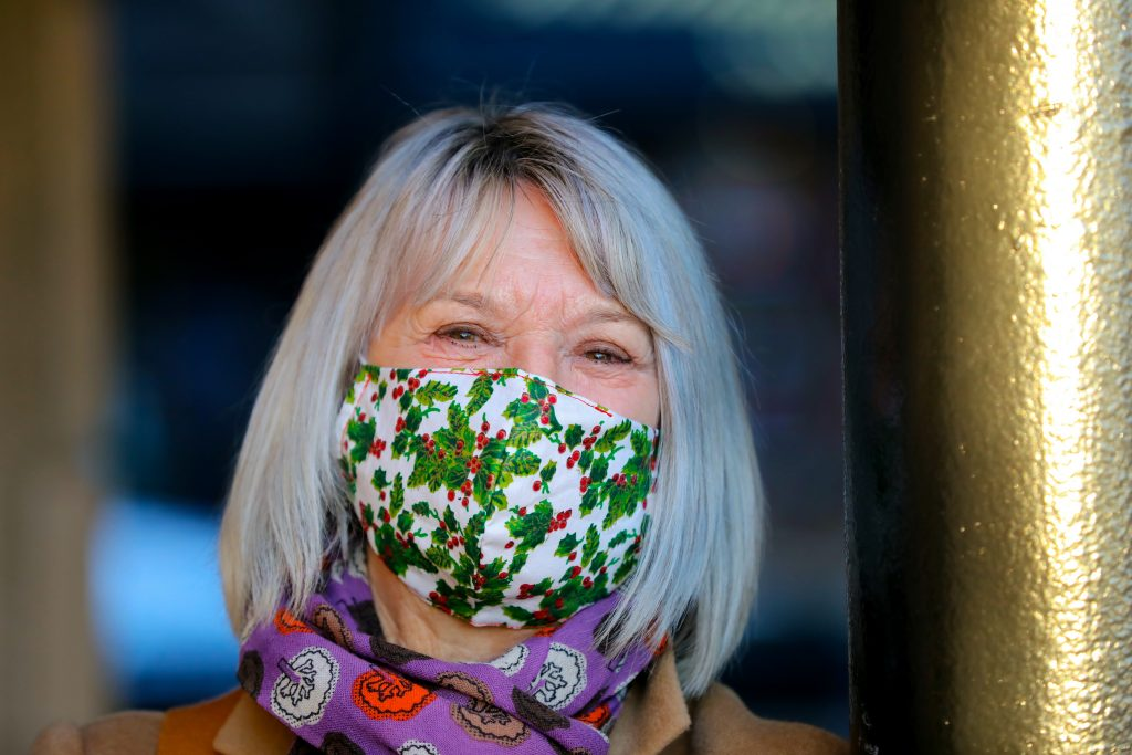 Linda wearing one of the masks she made and sold to fundraise