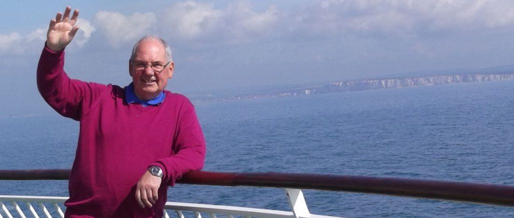 Iain waving from a boat